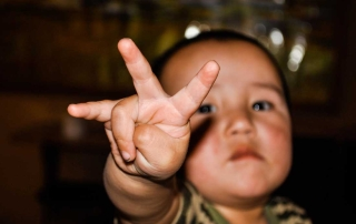 A baby boy counting to 3 or 4 - future musician in the making