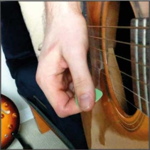 make sure the pick lands below the strings so you can do an upstroke immediately following the slap